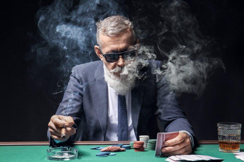 Man smoking at casino table