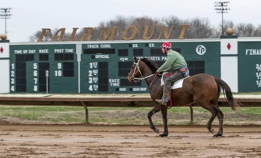 Horse & jockey riding at Fairmount Part Racetrack in Illinois