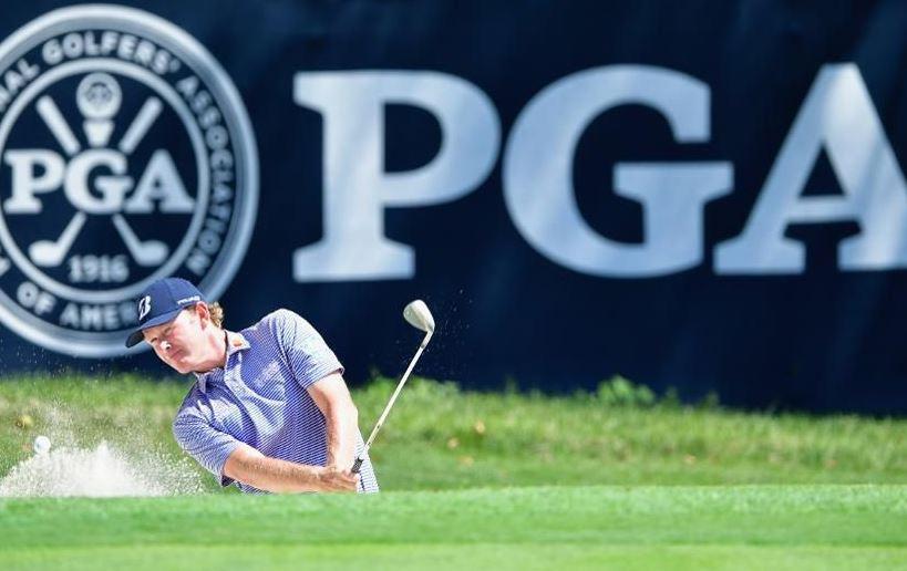 Professional golfer swinging his club