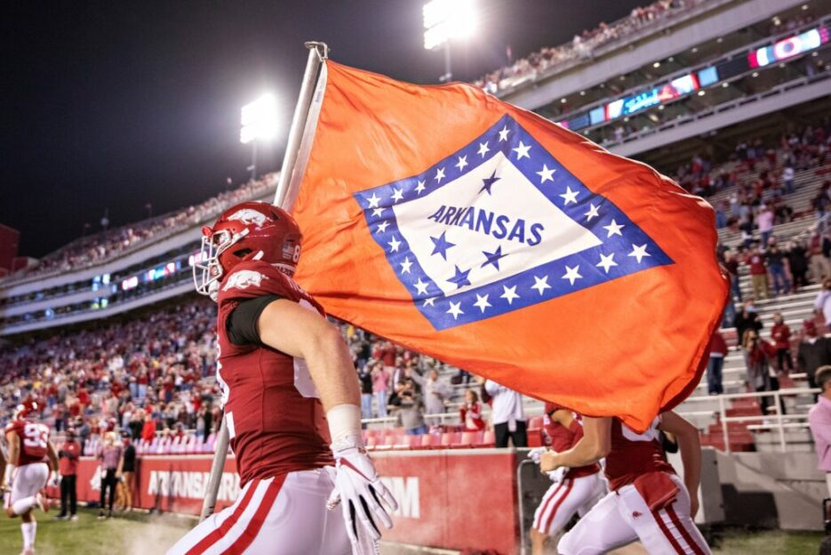 Arkansas state flag being held by an NFL player